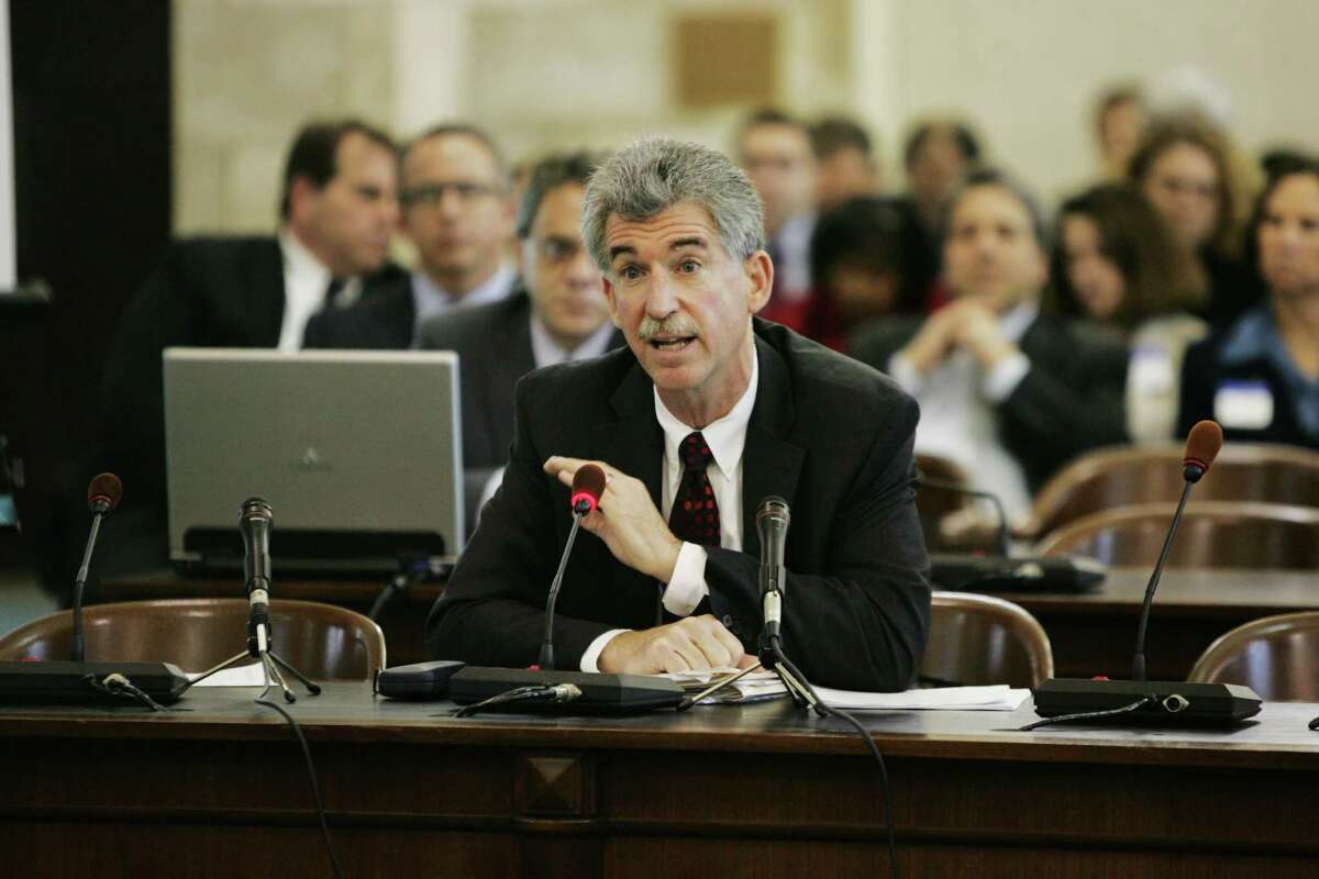 President of Jersey Central Power & Light Donald Lynch testifies in Trenton, N.J., Wednesday, Dec. 5, 2012. Public utility heads testify in front of a senate committee to testify about the utilities response to Hurricane Sandy. (AP Photo/The Record, Chris Pedota)