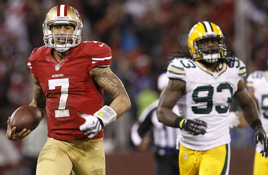 Colin Kaepernick leaves the Packers' defense, including Erik Walden (93), behind on a 56-yard TD run in the third quarter that put the 49ers ahead to stay. Photo: Brant Ward, The Chronicle