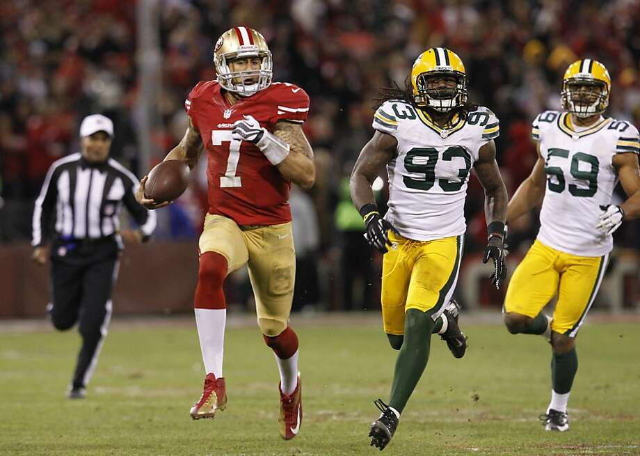 Colin Kaepernick took outside rushing alleys Green Bay gave him. Photo: Brant Ward, The Chronicle