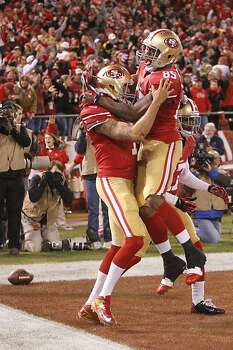 Quarterback Colin Kaepernick (7) celebrates with Tight end Vernon Davis (85) after running in for a touchdown in the first quarter of the San Francisco 49ers game against the Green Bay Packers in the NFC Divisional Playoffs at Candlestick Park in San Francisco, Calif., on Saturday January 12, 2013. Photo: Micheal Macor, The Chronicle