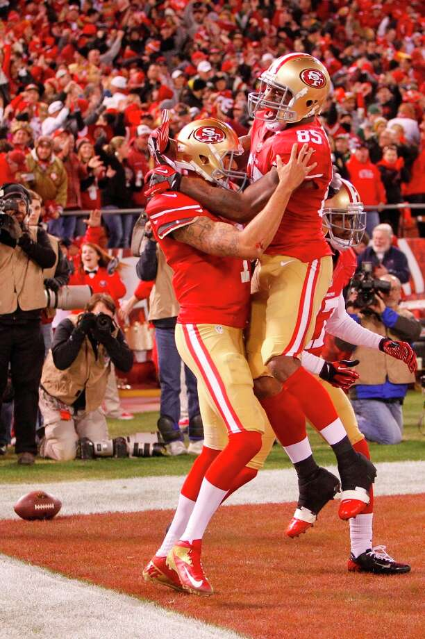 Quarterback Colin Kaepernick (7) celebrates with Tight end Vernon Davis (85) after running in for a touchdown in the first quarter of the San Francisco 49ers game against the Green Bay Packers in the NFC Divisional Playoffs at Candlestick Park in San Francisco, Calif., on Saturday January 12, 2013. Photo: Micheal Macor, The Chronicle / ONLINE_YES