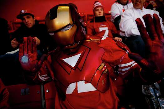Ron Graham, who came from the East Bay, poses for a photo while wearing an Ironman costume during a NFL football game between the San Francisco 49ers and Green Bay Packers at Candlestick Park in San Francisco, Calif. on Saturday, January 12, 2013. Photo: Stephen Lam, Special To The Chronicle / ONLINE_YES