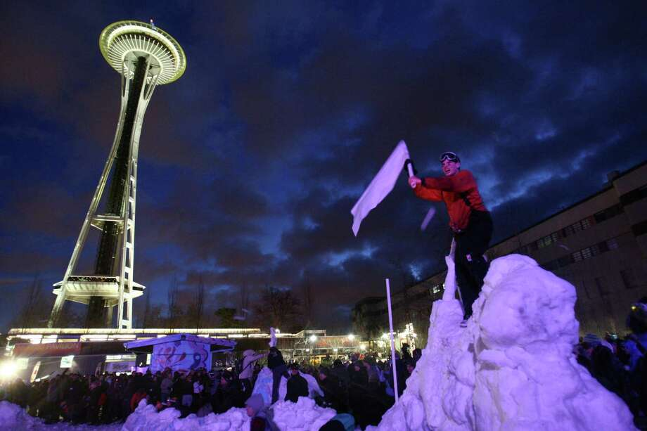 "People participate in ""Snow Day,"" a Guinness World Record-breaking snowball fight at the Seattle Center on Saturday, January 12, 2013. 5,834 people that passed through the gates were certified by Guinness World Records as participating in the projectile battle. Many more jumped the fences, adding to the total. The snow was trucked in from the Cascade mountains for the event. Photo: JOSHUA TRUJILLO, SEATTLEPI.COM / SEATTLEPI.COM"