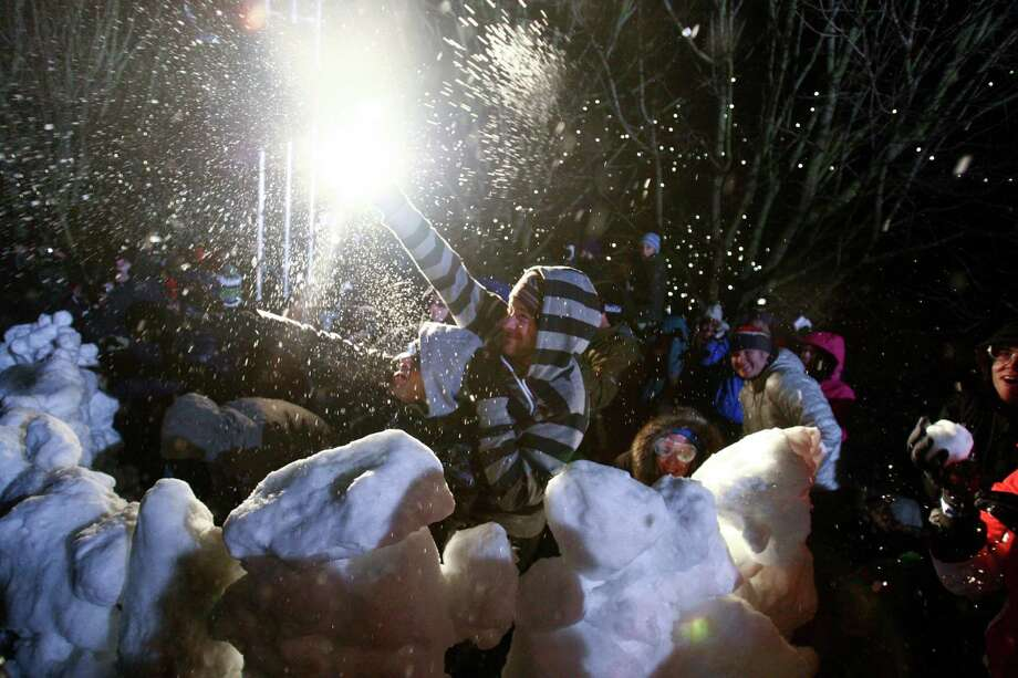 "People participate in ""Snow Day,"" a Guinness World Record-breaking snowball fight. Photo: JOSHUA TRUJILLO, SEATTLEPI.COM / SEATTLEPI.COM"