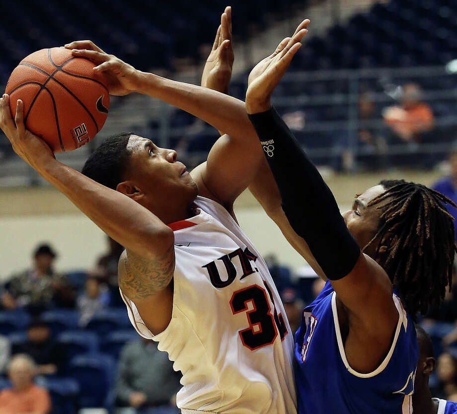 Roadrunner forward Jordan Sims tries a shot at the hoop against Cardarius Johnson as UTSA plays Louisiana Tech in mens' basketball at the UTSA Convocation Center  on January 12, 2013. Photo: Tom Reel, Express-News / ©2012 San Antono Express-News