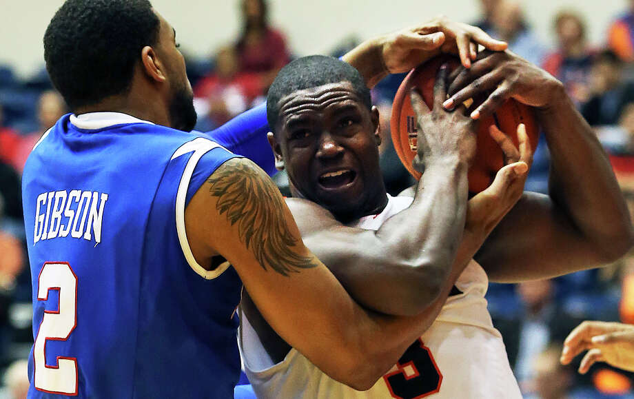 Raodrunner center Larry Wilkins fights with Brandon Gibson for a rebound as UTSA plays Louisiana Tech in mens' basketball at the UTSA Convocation Center  on January 12, 2013. Photo: Tom Reel, Express-News / ©2012 San Antono Express-News