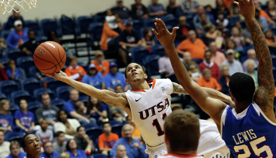 Michael Hale III stretches in for a layup for the Roadrunners as UTSA plays Louisiana Tech in mens' basketball at the UTSA Convocation Center  on January 12, 2013. Photo: Tom Reel, Express-News / ©2012 San Antono Express-News
