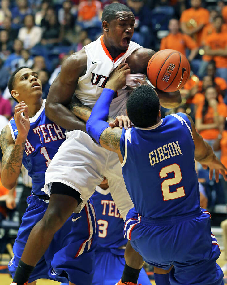 Roadrunner center Larry Wilkins wrestles with Bulldog defenders Michale Kyser (1) and Brandon Gibson under the UTSA basket in the second half as UTSA plays Louisiana Tech in mens' basketball at the UTSA Convocation Center  on January 12, 2013. Photo: Tom Reel, Express-News / ©2012 San Antono Express-News