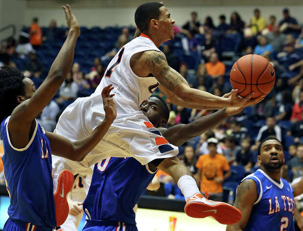 Roadrunner point guard Michael Hale III flies into the lane against the Bulldog defense as UTSA plays Louisiana Tech in mens' basketball at the UTSA Convocation Center  on January 12, 2013. Photo: Tom Reel, Express-News / ©2012 San Antono Express-News