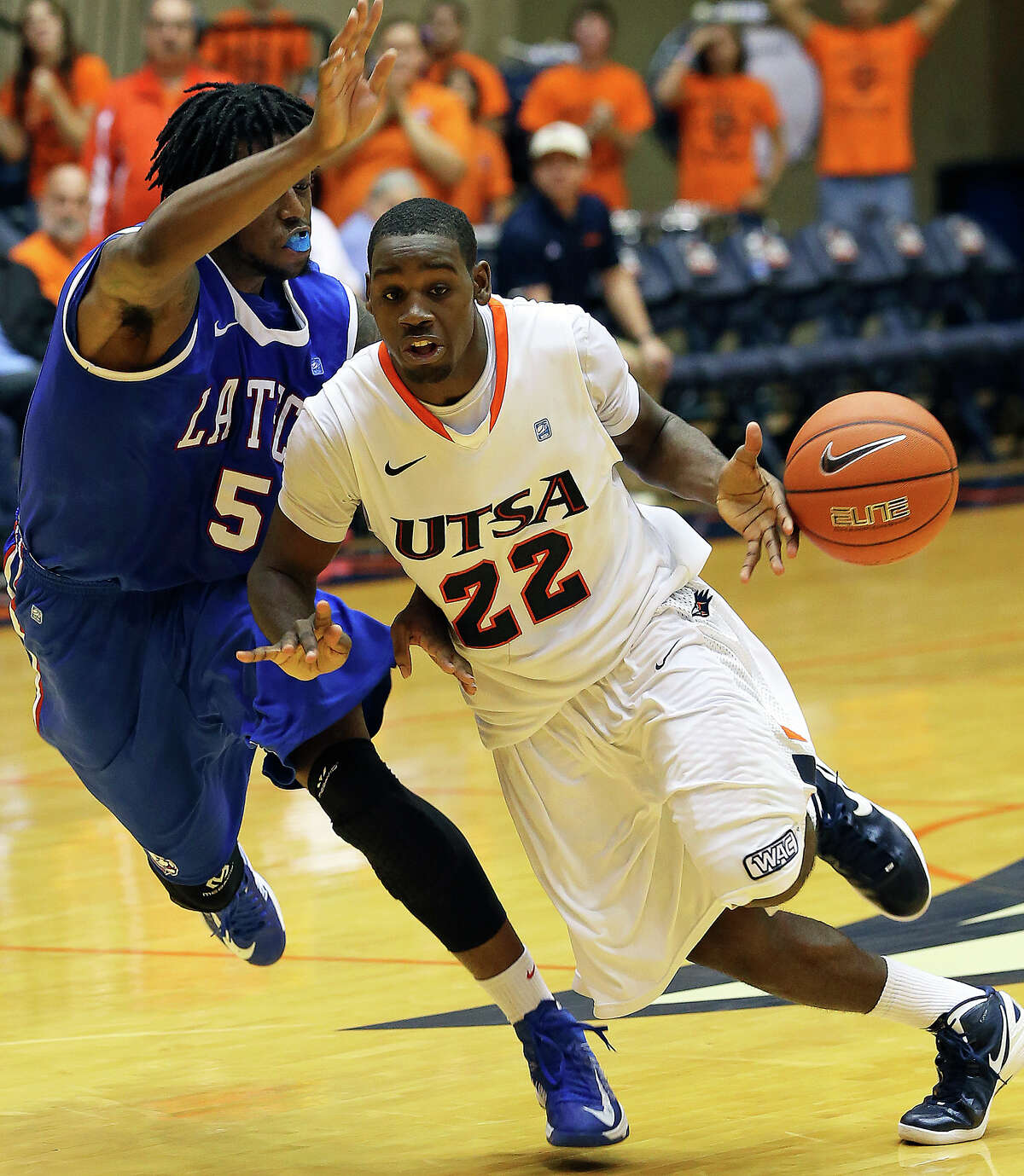 Roadrunner guard Kannon Burrage loses control of the ball on the last possession of the game as he drives past Chris Anderson with only seconds remaining as UTSA plays Louisiana Tech in mens' basketball at the UTSA Convocation Center on January 12, 2013.