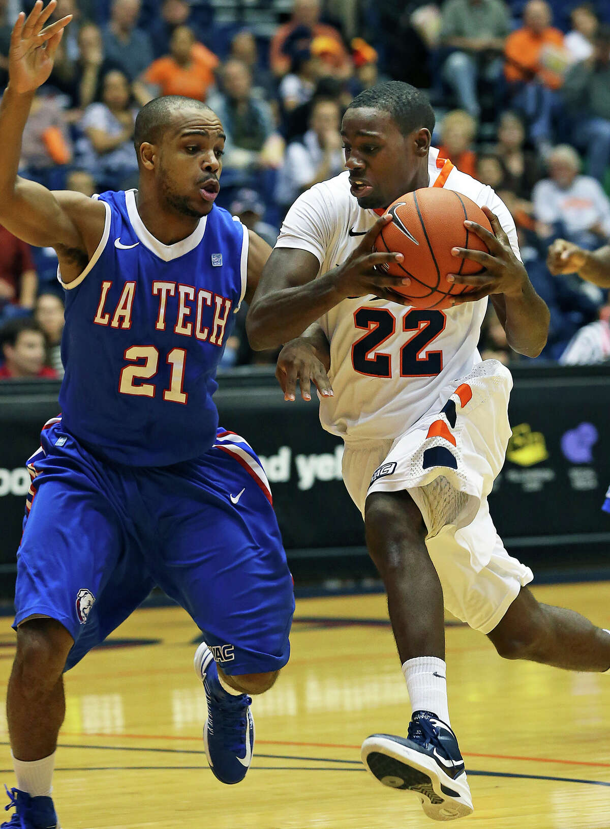 Roadrunner guard Kannon Burrage tries to get past Kenyon McNeail as UTSA plays Louisiana Tech in mens' basketball at the UTSA Convocation Center on January 12, 2013.