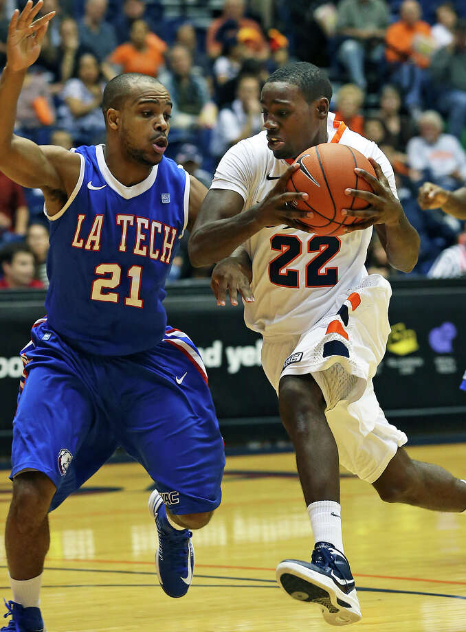 Roadrunner guard Kannon Burrage tries to get past Kenyon McNeail as UTSA plays Louisiana Tech in mens' basketball at the UTSA Convocation Center  on January 12, 2013. Photo: Tom Reel, Express-News / ©2012 San Antono Express-News