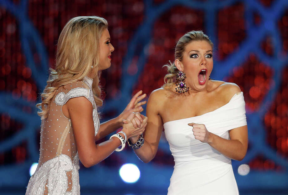 Miss New York, Mallory Hagan, right, reacts with Miss South Carolina Ali Rogers as she is crowned Miss America 2013 on Saturday, Jan. 12, 2013, in Las Vegas. (AP Photo/Isaac Brekken) Photo: Isaac Brekken, ASSOCIATED PRESS / AP2013