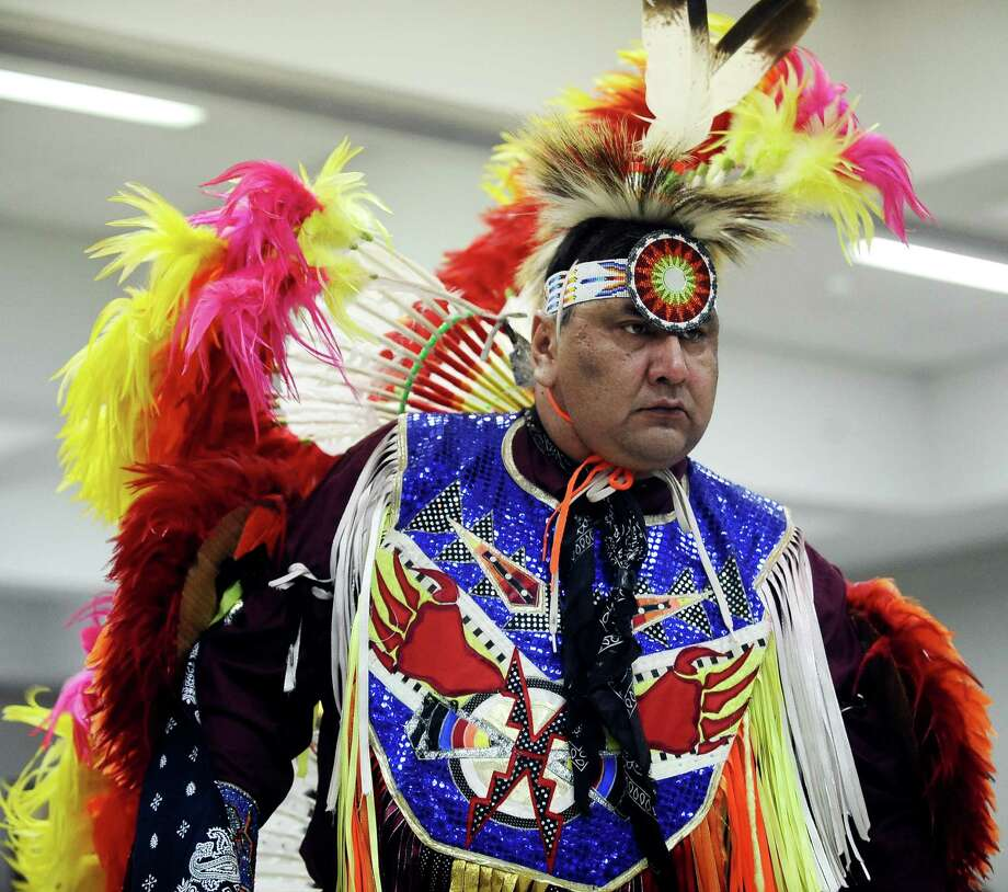 The Alabama-Coushatta Tribal Dancers introduce various styles of dance in their program during the reception after the celebration of the Message of Dr. Martin Luther King, Jr.  on Saturday, January 12, 2013, at Saint Anthony Cathedral Basilica in Beaumont.  Photo taken: Randy Edwards/The Enterprise Photo: Randy Edwards