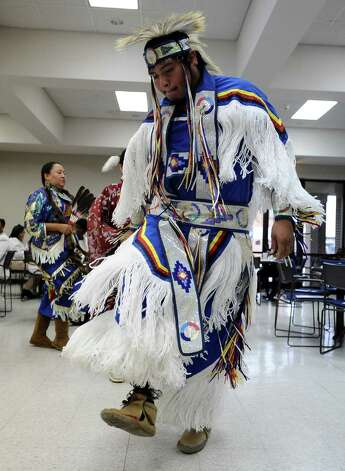 The Alabama-Coushatta Tribal Dancers introduce various styles of dance in their program during the reception after the celebration of the Message of Dr. Martin Luther King, Jr.  on Saturday, January 12, 2013, at Saint Anthony Cathedral Basilica in Beaumont.  Photo taken: Randy Edwards/The Enterprise