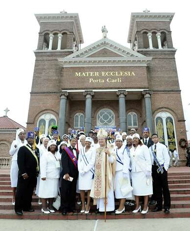 Bishop Curtis Guillory stands with the Knights of Peter Claver and the Ladies Auxillary after the celebration of the Message of Dr. Martin Luther King, Jr.  on Saturday, January 12, 2013, at Saint Anthony Cathedral Basilica in Beaumont.  Photo taken: Randy Edwards/The Enterprise Photo: Randy Edwards
