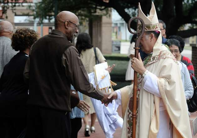Bishop Curtis Guillory greets supporters during the celebration of the Message of Dr. Martin Luther King, Jr.  on Saturday, January 12, 2013, at Saint Anthony Cathedral Basilica in Beaumont.  Photo taken: Randy Edwards/The Enterprise Photo: Randy Edwards