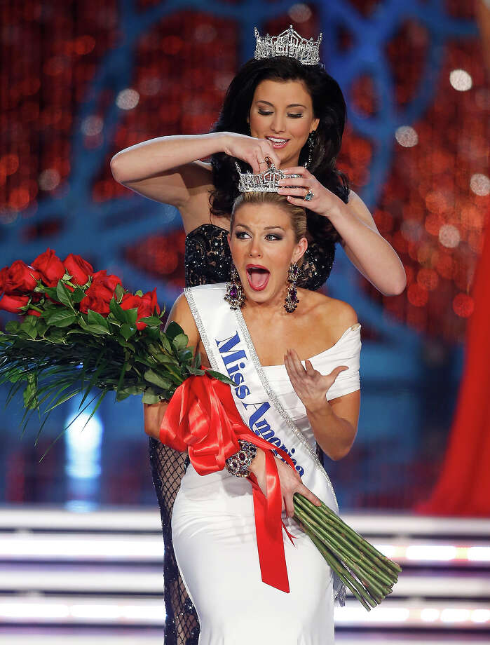 Miss New York Mallory Hagan is crowned Miss America 2013 by Miss America 2012 Laura Kaeppeler on Saturday, Jan. 12, 2013, in Las Vegas. (AP Photo/Isaac Brekken) Photo: Isaac Brekken, ASSOCIATED PRESS / AP2013