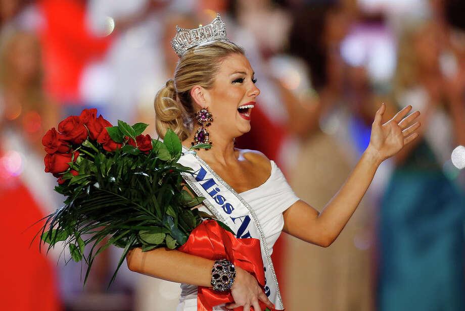 Miss New York Mallory Hagan waves after she was crowned Miss America 2013 on Saturday, Jan. 12, 2013, in Las Vegas. (AP Photo/Isaac Brekken) Photo: Isaac Brekken, ASSOCIATED PRESS / AP2013