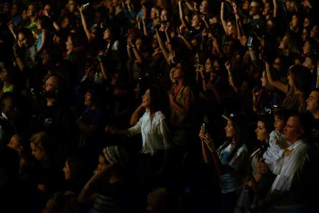 "Fans watch as Justin Bieber performs at the AT&T Center on a stop of the ""Believe"" tour on Saturday night, Jan. 12, 2013. Photo: Billy Calzada, San Antonio Express-News / SAN ANTONIO EXPRESS-NEWS"