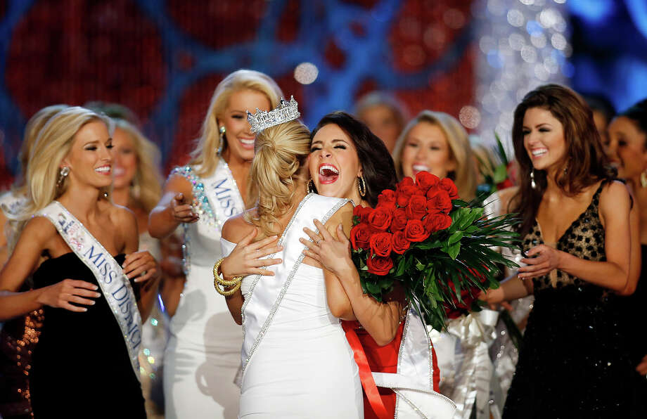 Miss Georgia Leighton Jordan, center, congratulates Miss New York Mallory Hytes Hagan for winning the Miss America 2013 pageant on Saturday, Jan. 12, 2013, in Las Vegas. (AP Photo/Isaac Brekken) Photo: Isaac Brekken, ASSOCIATED PRESS / AP2013