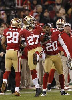 Safety C.J. Spillman (27), Cornerback Perrish Cox (20) and Running back Darcel McBath (28) celebrator after a recovered fumble in the second quarter of the San Francisco 49ers game against the Green Bay Packers in the NFC Divisional Playoffs at Candlestick Park in San Francisco, Calif., on Saturday January 12, 2013. Photo: Carlos Avila Gonzalez, The Chronicle