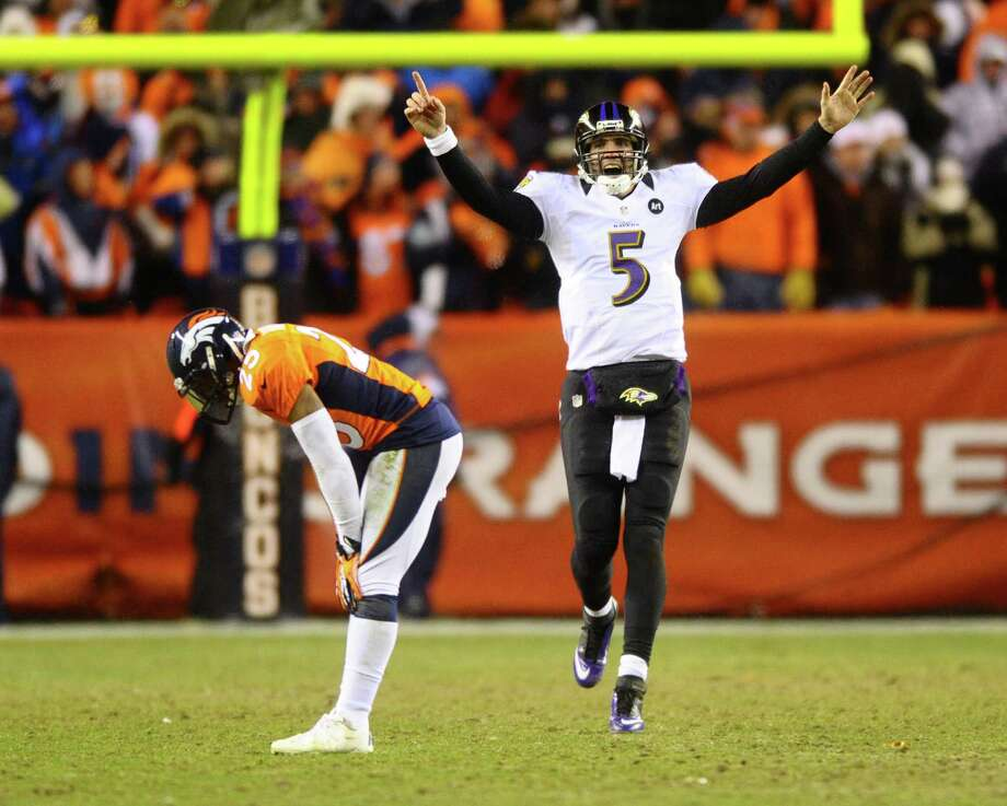 Baltimore Ravens quarterback Joe Flacco (5) celebrates his 70-yard touchdown pass to Jacoby Jones late in the fourth quarter as the Denver Broncos' Chris Harris is bent over with grief in the AFC Divisonal Playoff at Sports Authority Field at Mile High in Denver, Colorado, on Saturday, January 12, 2013. Baltimore won in OT, 38-35. (Mark Reis/Colorado Springs Gazette/MCT) Photo: Mark Reis, MBR / Colorado Springs Gazette