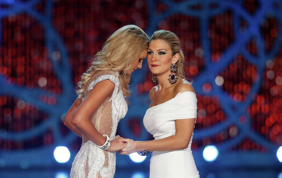 Miss South Carolina Ali Rogers, left, and Miss New York, Mallory Hytes Hagan, right, wait for the announcement of the winner during the Miss America 2013 pageant on Saturday, Jan. 12, 2013, in Las Vegas. Hytes Hagan won the competition. (AP Photo/Isaac Brekken) Photo: Isaac Brekken, ASSOCIATED PRESS / AP2013