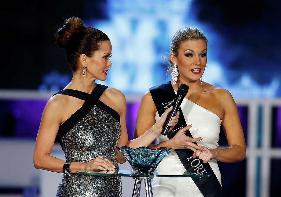 Miss New York Mallory Hytes Hagan, right,  answers a question with host Brooke Burke during the Miss America 2013 pageant on Saturday, Jan. 12, 2013, in Las Vegas. Hytes Hagan was later crowned Miss America 2013. (AP Photo/Isaac Brekken) Photo: Isaac Brekken, ASSOCIATED PRESS / AP2013