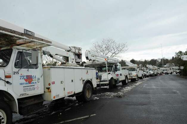 Trucks from Texoma Powerline Inc. from Sayre, in OK parks at Grass Island Marina in Greenwich, Conn., Thursday, Nov. 8, 2012. Out of state crews were brought in to help restore power after damage from Super Storm Sandy hit the area. Photo: Helen Neafsey / Greenwich Time