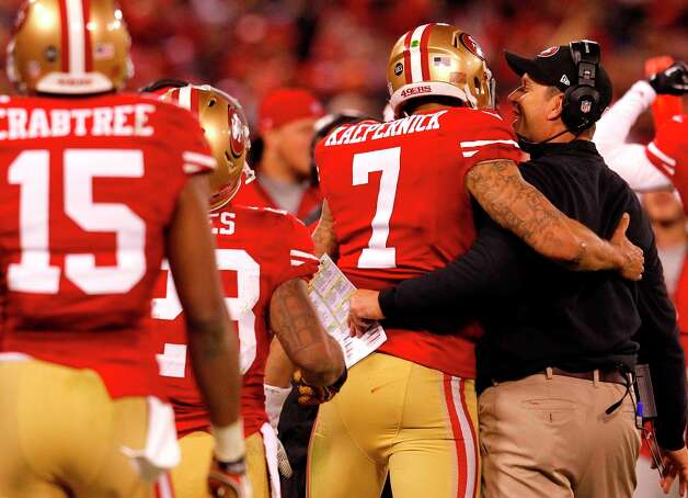San Francisco 49ers Quarterback Colin Kaepernick (7) celebrates with coach Jim Harbaugh after a touchdown in the third quarter of the San Francisco 49ers game against the Green Bay Packers in the NFC Divisional Playoffs at Candlestick Park in San Francisco, Calif., on Saturday January 12, 2013. Photo: Brant Ward, The Chronicle / ONLINE_YES