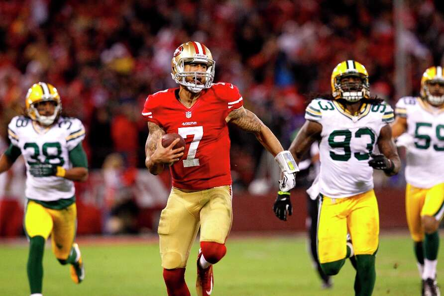 San Francisco 49ers Quarterback Colin Kaepernick (7) runs in for a touchdown in the third quarter of