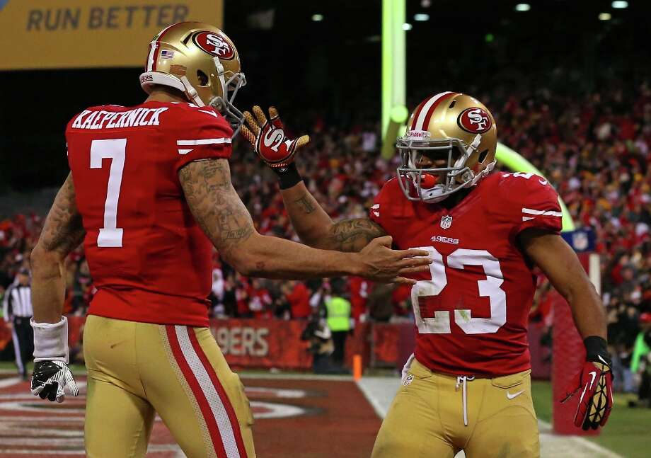 Quarterback Colin Kaepernick #7 of the San Francisco 49ers celebrates with running back LaMichael James #23 after running the ball for a touchdown against the Green Bay Packers in the third quarter during the NFC Divisional Playoff Game at Candlestick Park on January 12, 2013 in San Francisco, California. Photo: Stephen Dunn, Getty Images / 2013 Getty Images