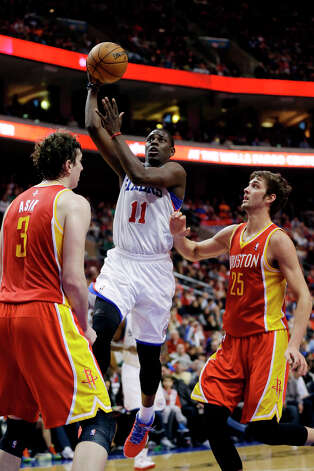 Jan. 12: 76ers 107, Rockets 100Jrue Holiday, center, goes up for a shot as Omer Asik, left, of Turkey, and Chandler Parsons defend. Photo: Matt Slocum, Associated Press / AP
