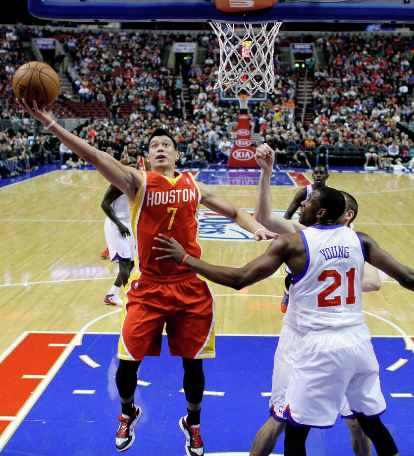 Jeremy Lin, left, goes up for a shot against Thaddeus Young. Photo: Matt Slocum, Associated Press / AP