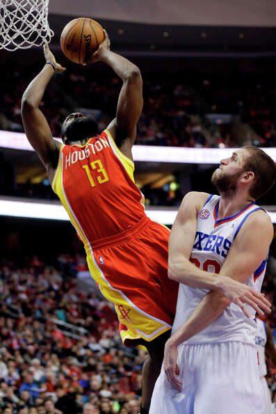 James Harden, left, goes up for a shot against Spencer Hawes.