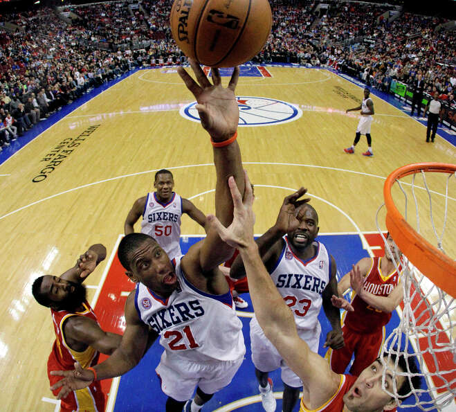 Thaddeus Young (21) and Jason Richardson (23) leap for a rebound against James Harden, left, and Car
