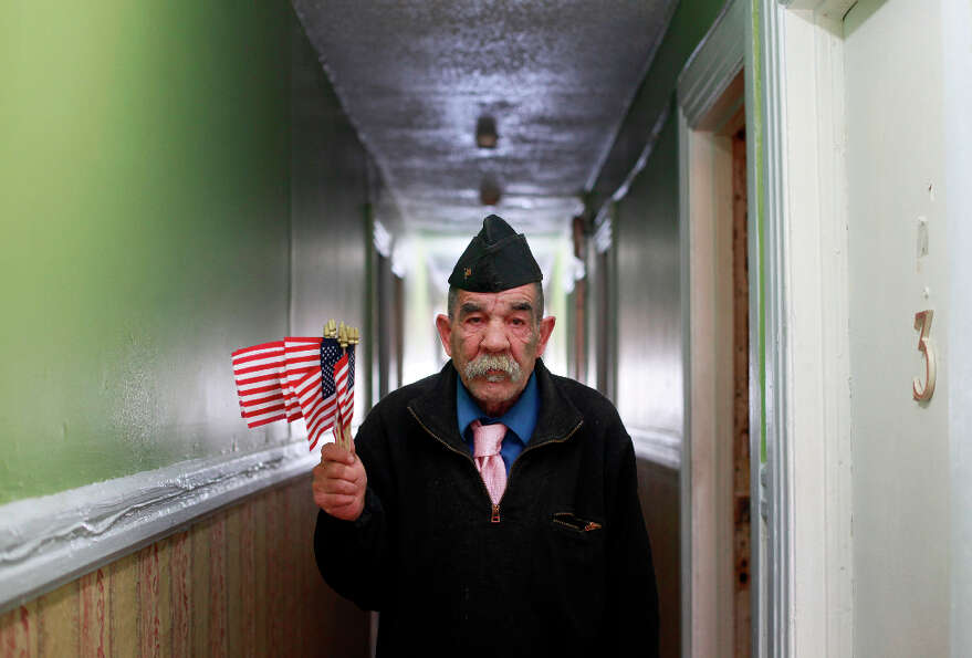 Disabled Vet Philip Myers wears the class A Army uniform hat he was issued in 1969.