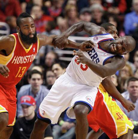 In a role reversal for the Rockets guard, James Harden (13) fouls the 76ers' Jason Richardson. Harden led the Rockets with 29 points. Photo: RON CORTES, MBR / Philadelphia Inquirer