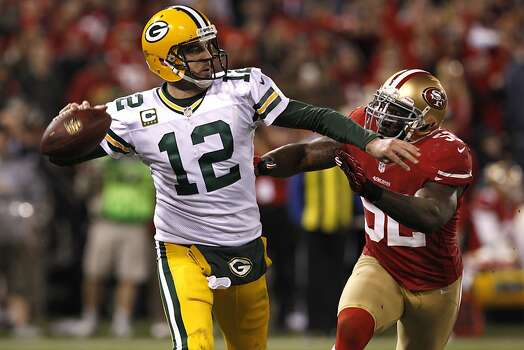 Quarterback Aaron Rodgers (12) throws past Linebacker Patrick Willis (52) during the San Francisco 49ers game against the Green Bay Packers in the NFC Divisional Playoffs at Candlestick Park in San Francisco, Calif., on Saturday January 12, 2013. Photo: Carlos Avila Gonzalez, The Chronicle