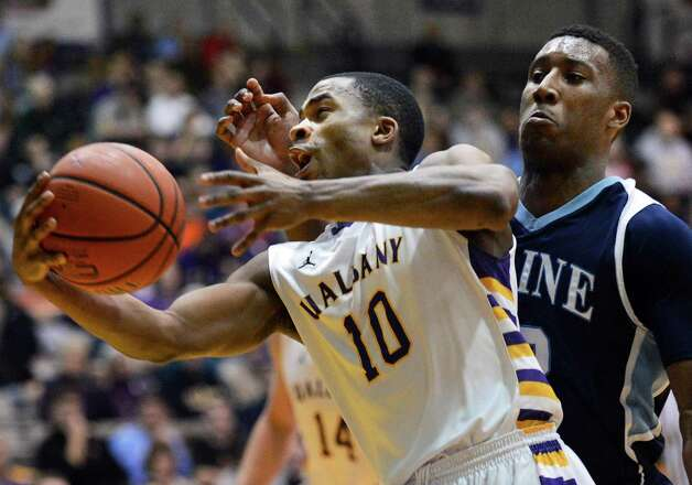 UAlbany's #10 Mike Black blasts through Maine's #12 Xavier Pollard during Saturday's America East game at the SEFCU Arena in Albany Jan. 12, 2013.  (John Carl D'Annibale / Times Union) Photo: John Carl D'Annibale / 00020702A