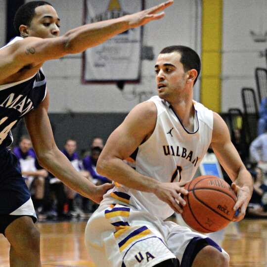 UAlbany's #0 Jacob Iati, at right, and Maine's #14 Justin Edwards during Saturday's America East gam