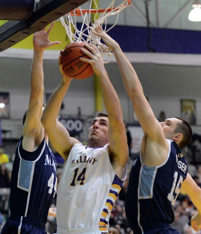 UAlbany's #14, Sam Rowley is double teamed by Maine defenders during Saturday's America East game at the SEFCU Arena in Albany Jan. 12, 2013.  (John Carl D'Annibale / Times Union) Photo: John Carl D'Annibale / 00020702A