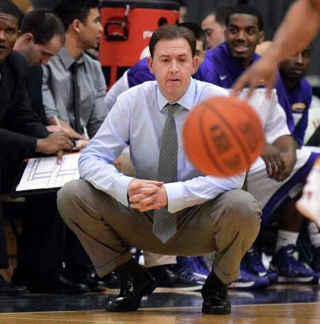 UAlbany head coach Will Brown watches Saturday's America East game against Maine at the SEFCU Arena in Albany Jan. 12, 2013.  (John Carl D'Annibale / Times Union) Photo: John Carl D'Annibale / 00020702A