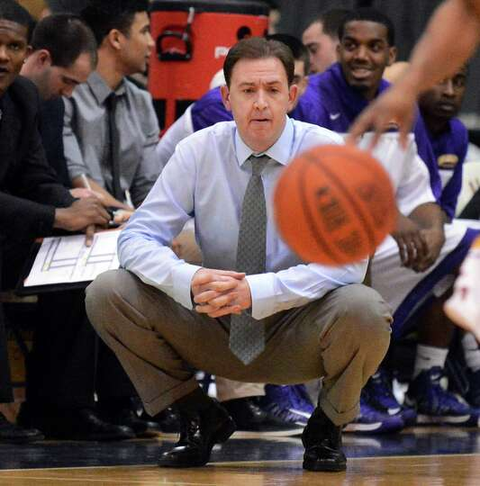 UAlbany head coach Will Brown watches Saturday's America East game against Maine at the SEFCU Arena