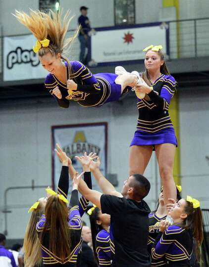 UAlbany cheerleaders perform during Saturday's America East game against Maine at the SEFCU Arena in