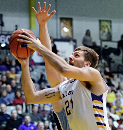 UAlbany's #21 Blake Metcalf drives to the basket against Maine during Saturday's America East game a