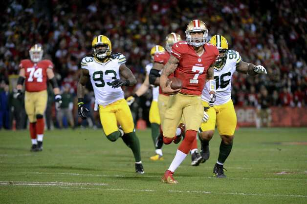SAN FRANCISCO, CA - JANUARY 12:  Quarterback Colin Kaepernick #7 of the San Francisco 49ers runs for a touchdown in the first quarter against the Green Bay Packers during the NFC Divisional Playoff Game at Candlestick Park on January 12, 2013 in San Francisco, California.  (Photo by Harry How/Getty Images) Photo: Harry How