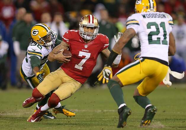 49ers' quarterback Colin Kaepernick picks up a fourth quarter first down,  as the San Francisco 49ers defeat the Green Bay Parkers 45-31, in the National Football Conference divisional playoffs, at Candlestick Park, on Saturday Jan. 12, 2012, in San Francisco, Calif. Photo: Michael Macor, The Chronicle
