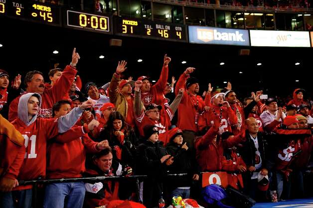 Football fans cheer from the stand after San Francisco 49ers defeated Green Bay Packers 45-31in their NFL football divisional playoff at Candlestick Park in San Francisco, Calif. on Saturday, January 12, 2013. Photo: Stephen Lam, Special To The Chronicle / ONLINE_YES